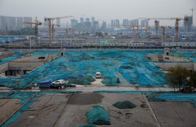 Construction sites are seen next to Zhengzhou East Railway Station in Zhengzhou, Henan province, China November 29, 2019.  REUTERS/Jason Lee