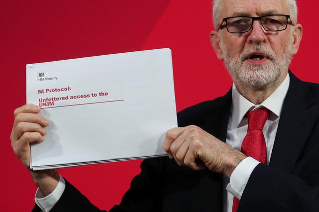 Britain's opposition Labour Party leader Jeremy Corbyn shows a document during a news conference in London, Britain December 6, 2019. REUTERS/Yves Herman