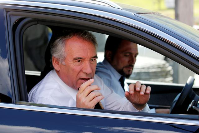 FILE PHOTO: Francois Bayrou, leader of Mouvement Democrate (Democratic Movement), is seen in his car as he arrives to visit the Pic du Midi in the Pyrenees mountain with French President Emmanuel Macron (not pictured) at La Mongie in Bagneres-de-Bigorre, France, July 26, 2018.   REUTERS/Regis Duvignau/Pool
