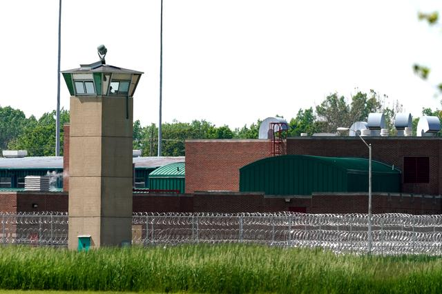 FILE PHOTO: A correction officer keeps watch from a tower at The Federal Corrections Complex in Terre Haute, Indiana, U.S. May 22, 2019.  REUTERS/Bryan Woolston