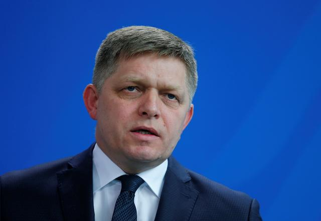 FILE PHOTO: Slovakian Prime Minister Robert Fico speaks during the news conference at the Chancellery in Berlin, Germany, April 3, 2017. REUTERS/Hannibal Hanschke/File Photo