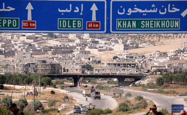 FILE PHOTO: Road direction signs are pictured at the entrance en route to Khan Sheikhoun, Idlib, Syria August 24, 2019. REUTERS/Omar Sanadiki/File Photo