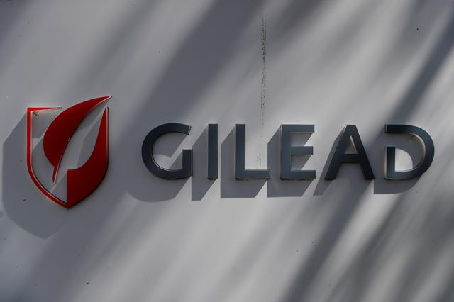 FILE PHOTO: A Gilead Sciences, Inc. logo is seen outside the company headquarters in Foster City, California, U.S. May 1, 2018. REUTERS/Stephen Lam/File Photo