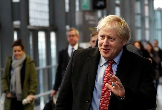 FILE PHOTO: Britain's Prime Minister Boris Johnson arrives on the platform to board a train in London, Britain December 6, 2019.  REUTERS/Peter Nicholls/Pool/File Photo