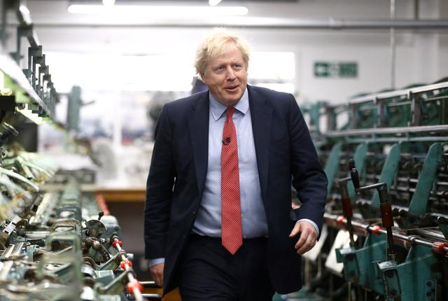 FILE PHOTO: Britain's Prime Minister Boris Johnson visits John Smedley Mill in Matlock, Derbyshire, Britain December 5, 2019. REUTERS/Hannah McKay/Pool/File Photo