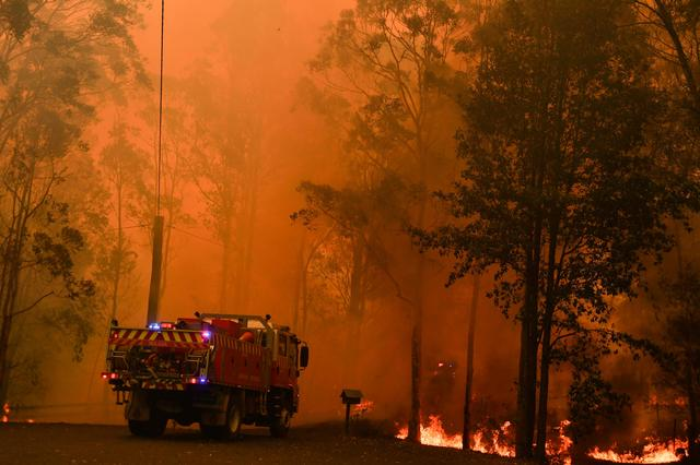FILE PHOTO: Fire trucks are seen during a bushfire in Werombi, 50 km southwest of Sydney, Australia, December 6, 2019. AAP Image/Mick Tsikas/via REUTERS/File Photo