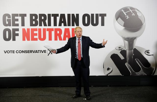 FILE PHOTO: Britain's Prime Minister Boris Johnson gestures during the launch of a general campaign poster at the Kent Showground in Detling, Kent, Britain, December 6, 2019.  REUTERS/Peter Nicholls/Pool
