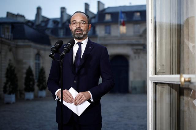 FILE PHOTO: French Prime Minister Edouard Philippe delivers a statement at the Hotel Matignon in Paris following a massive strike and protests against the government pensions reforms plan in France, December 6, 2019. REUTERS/Benoit Tessier
