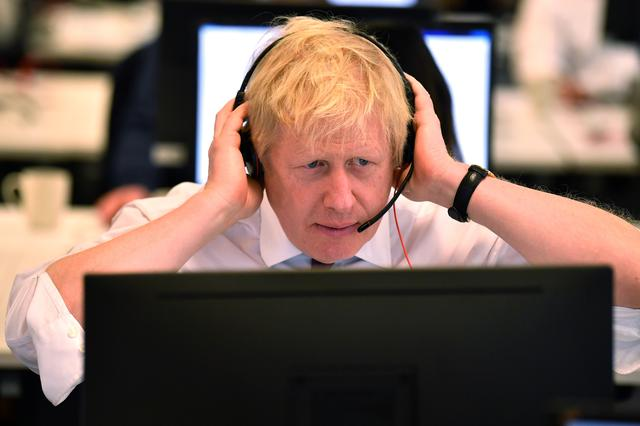 Britain's Prime Minister Boris Johnson speaks to a caller at the Conservative Campaign Headquarters Call Centre in central London, Britain, December 8, 2019. Ben Stansall/Pool via REUTERS
