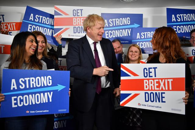 Britain's Prime Minister Boris Johnson speaks to activists and supporters as he poses for a photograph at the Conservative Campaign Headquarters Call Centre in central London, Britain, December 8, 2019. Ben Stansall/Pool via REUTERS