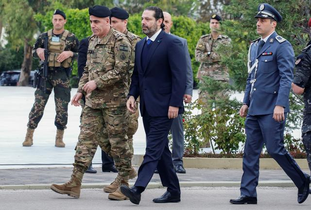 FILE PHOTO: Lebanon's caretaker Prime Minister Saad al-Hariri arrives to attend a military parade to mark the 76th anniversary of Lebanon's independence at the Ministry of Defense in Yarze, Lebanon November 22, 2019. REUTERS/Mohamed Azakir/File Photo