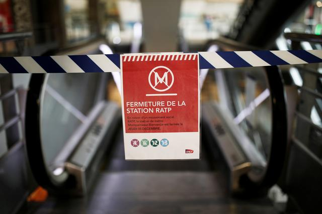 A sign reading metro lines closed is seen at Gare Montparnasse train station as a strike by French SNCF railway and Paris transport network (RATP) workers continues against French government's pensions reform plans, in Paris, France, December 8, 2019. REUTERS/Benoit Tessier