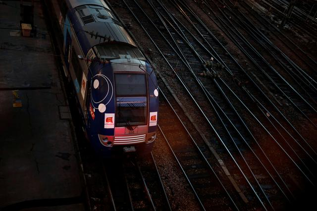 A regional train, operated by French national railway operator SNCF, stands at the Saint-Lazare railway station as a strike by French SNCF railway and Paris transport network (RATP) workers continues against French government's pensions reform plans, in Paris, France, December 8, 2019. REUTERS/Benoit Tessier