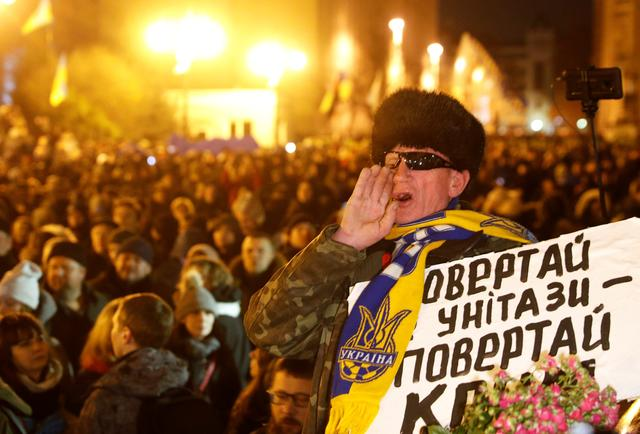 """A demonstrator shouts during a rally ahead of the so-called """"Normandy"""" format summit in Paris, where leaders of Ukraine, Russia, Germany and France will meet to discuss steps to resolve the conflict in eastern Ukraine, in Kiev, Ukraine December 8, 2019. REUTERS/Valentyn Ogirenko"""