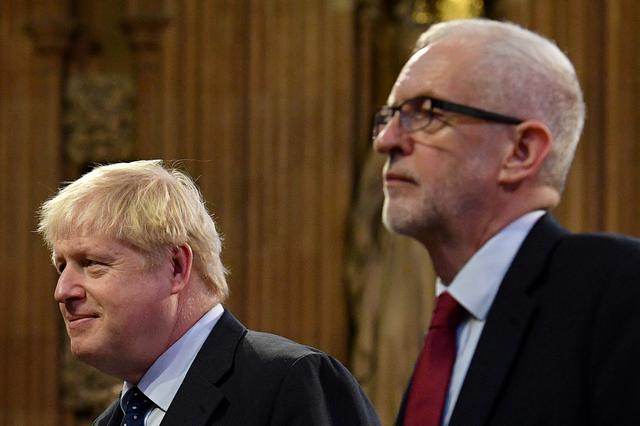 FILE PHOTO: Britain's Prime Minister Boris Johnson and main opposition Labour Party leader Jeremy Corbyn head the procession of members of parliament through the Central Lobby toward the House of Lords to listen to the Queen's Speech during the State Opening of Parliament in the Houses of Parliament in London, Britain October 14, 2019. Daniel Leal-Olivas/Pool via REUTERS/File Photo