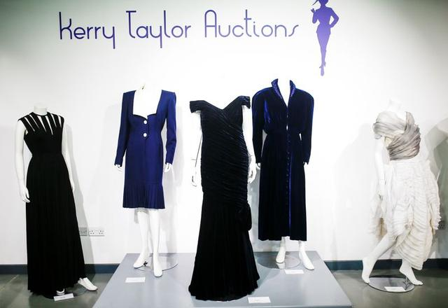 Britain's Princess Diana's Victor Edelstein midnight-blue velvet evening gown (estimated at £250,000 - £350,000), which was worn by the princess when she danced with actor John Travolta at the White House in 1985. Also pictured is her Katherine Cusack evening gown (estimated at £20,000  -£30,000) and her Catherine Walker dress (estimated £4,000 - £6,000), displayed at Kerry Taylor auctions in London, Britain December 8, 2019. REUTERS/Henry Nicholls