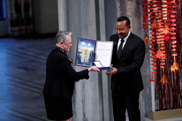 Ethiopian Prime Minister Abiy Ahmed Ali receives medal and diploma from Chair of the Nobel Comitteee Berit Reiss-Andersen during Nobel Peace Prize awarding ceremony in Oslo City Hall, Norway December 10, 2019. NTB Scanpix/Terje Bendiksby via REUTERS