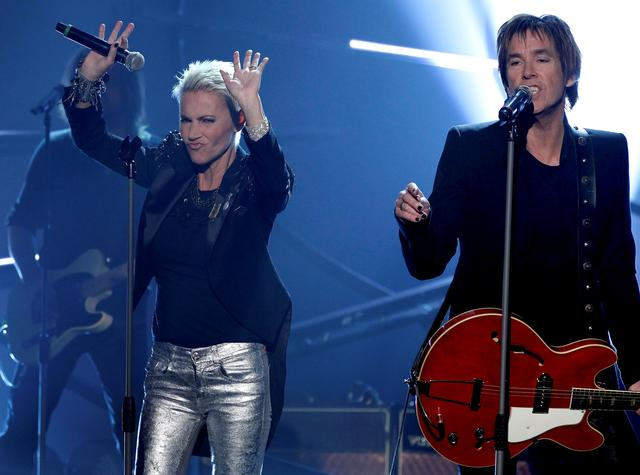 "FILE PHOTO: Marie Fredriksson (L) and Per Gessle of Swedish pop duo Roxette perform during the German game show ""Wetten Dass"" (Bet it...?) in Halle, Germany, February 13, 2011. Fredriksson died on Monday at the age of 61 after having spent years battling cancer and the lingering effects of its treatment, her manager said./File Photo"