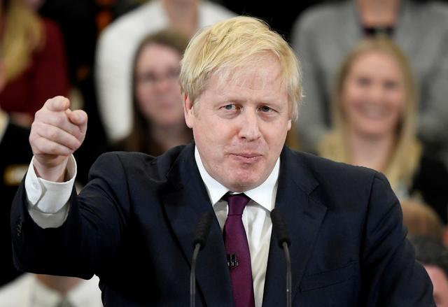 FILE PHOTO: Britain's Prime Minister Boris Johnson speaks to the workers as he visits a JCB factory during his general election campaign in Uttoxeter, Britain, December 10, 2019.  REUTERS/Toby Melville
