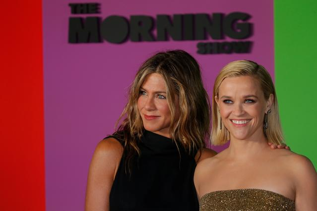 "FILE PHOTO: Reese Witherspoon (R) and Jennifer Aniston arrive to the global premiere for Apple's ""The Morning Show"" at the Lincoln Center in the Manhattan borough of New York City, U.S., October 28, 2019. REUTERS/Eduardo Munoz"