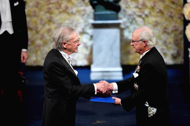 Austrian author Peter Handke shakes hands with Sweden's King Carl Gustaf as he receives the 2019 Nobel Prize during the Nobel Prize award ceremony at the Stockholm Concert Hall in Stockholm, Sweden December 10, 2019.   TT News Agency/Henrik Montgomery via REUTERS