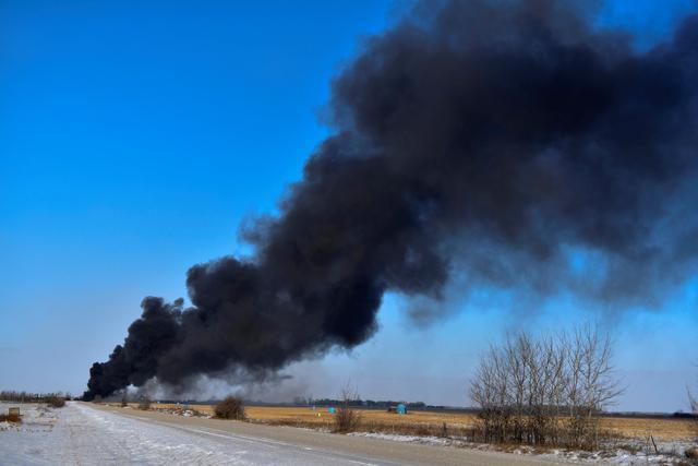 Smoke billows from the wreckage of a derailed Canadian Pacific Railway train hauling crude oil, near Guernsey, Saskatchewan, Canada December 9, 2019.  REUTERS/Kayle Neis