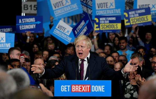 Britain's Prime Minister Boris Johnson speaks at a general election campaign event at the Globus Group warehouse in Manchester, Britain, December 10, 2019. REUTERS/Toby Melville