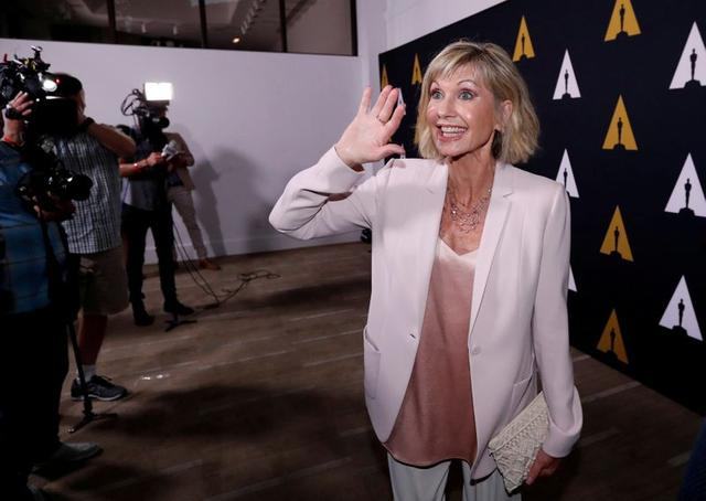 """FILE PHOTO: Cast member Olivia Newton-John attends a 40th anniversary screening of """"Grease"""" at the Academy of Motion Picture Arts and Sciences in Beverly Hills, California, U.S., August 15, 2018. REUTERS/Mario Anzuoni/File Photo"""