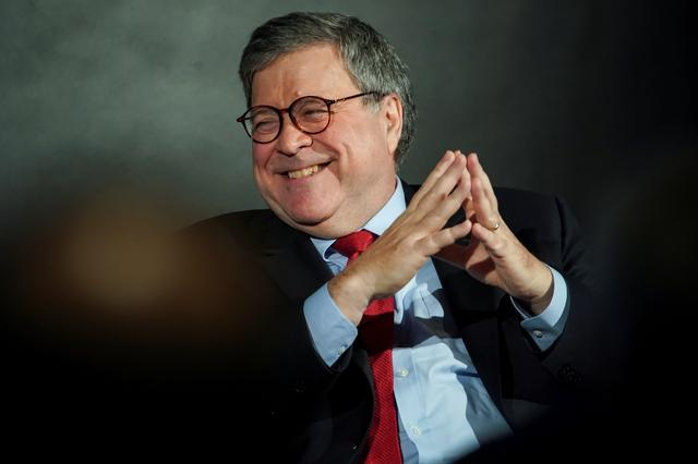 U.S. Attorney General William Barr smiles while speaking during the Wall Street Journal CEO Council, in Washington, U.S., December 10, 2019. REUTERS/Al Drago