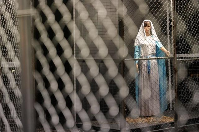 A sculpture of Mary, depicted as a refugee in a cage, forms part of a Nativity scene at Claremont United Methodist Church in Claremont, California, U.S. December 9, 2019.  REUTERS/Kyle Grillot