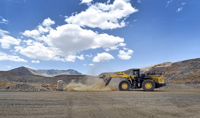 FILE PHOTO: A front-end loader is used to reinforce a safety berm inside the open pit at  a rare earth facility in California June 29, 2015. REUTERS/David Becker/File Photo