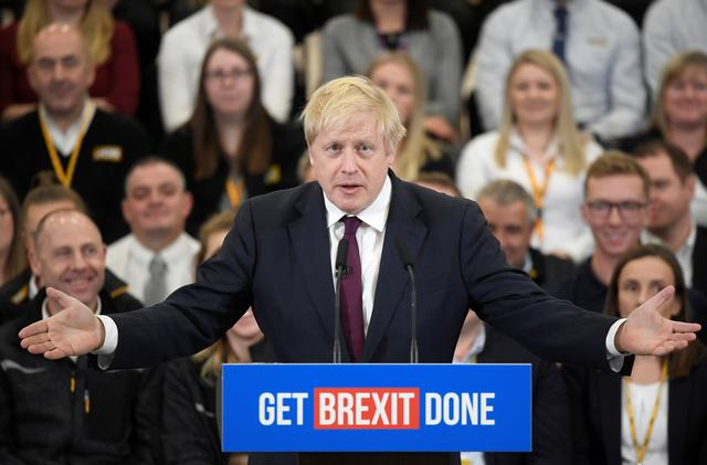 Britain's Prime Minister Boris Johnson speaks to the workers as he visits a JCB factory during his general election campaign in Uttoxeter, Britain, December 10, 2019.  REUTERS/Toby Melville