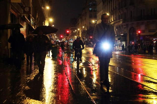 People walk on the street as a strike by all unions of the Paris transport network (RATP) and French SNCF workers entered its seventh consecutive day in Paris, France, December 11, 2019. REUTERS/Eric Gaillard