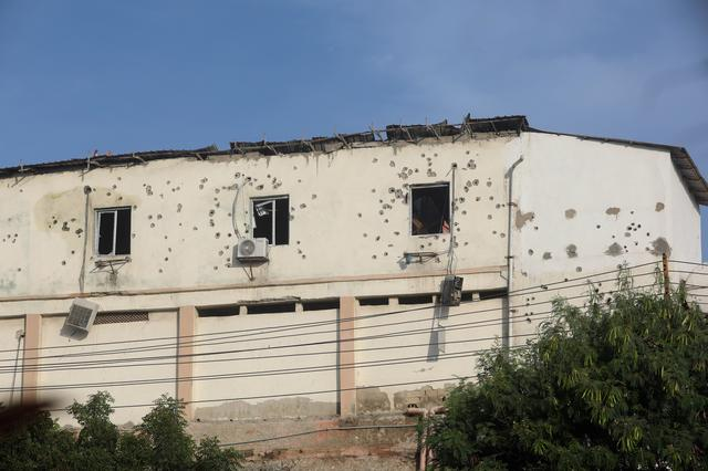 Bullet holes are seen around the windows of the SYL hotel after fighting between Somali security forces and Al Shabaab gunmen, who lunched an attack on the hotel near the presidential residence in Mogadishu, Somalia December 11, 2019. REUTERS/Feisal Omar