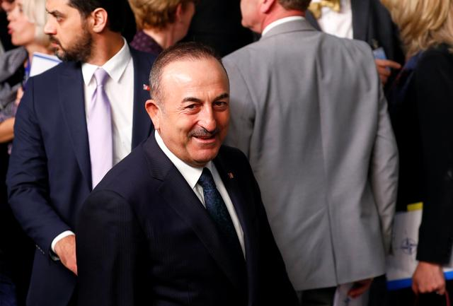 FILE PHOTO: Turkish Foreign Minister Mevlut Cavusoglu attends a NATO foreign ministers meeting in Brussels, Belgium, November 20, 2019. REUTERS/Francois Lenoir/File Photo