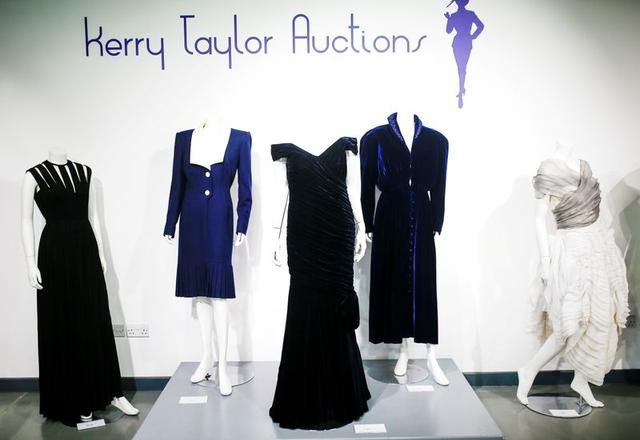 FILE PHOTO: Britain's Princess Diana's Victor Edelstein midnight-blue velvet evening gown (estimated at £250,000 - £350,000), which was worn by the princess when she danced with actor John Travolta at the White House in 1985. Also pictured is her Katherine Cusack evening gown (estimated at £20,000  -£30,000) and her Catherine Walker dress (estimated £4,000 - £6,000), displayed at Kerry Taylor auctions in London, Britain December 8, 2019. REUTERS/Henry Nicholls/File Photo