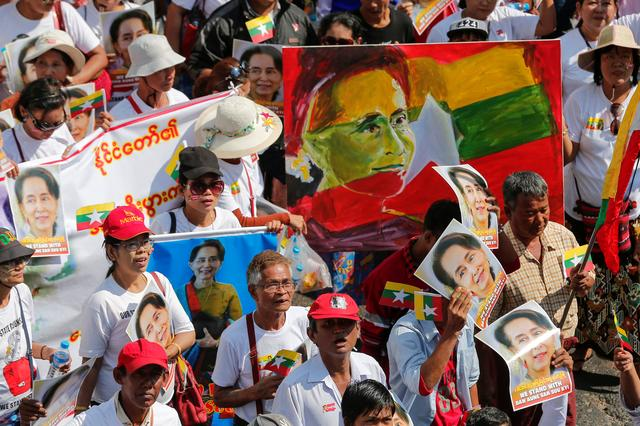 People gather to rally in support of Myanmar State Counsellor Aung San Suu Kyi before she attends a hearing at the International Court of Justice (ICJ), in Yangon, Myanmar December 10, 2019. REUTERS/Myat Thu Kyaw