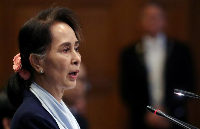 Myanmar's leader Aung San Suu Kyi speaks on the second day of hearings in a case filed by Gambia against Myanmar alleging genocide against the minority Muslim Rohingya population, at the International Court of Justice (ICJ) in The Hague, Netherlands December 11, 2019.  REUTERS/Yves Herman