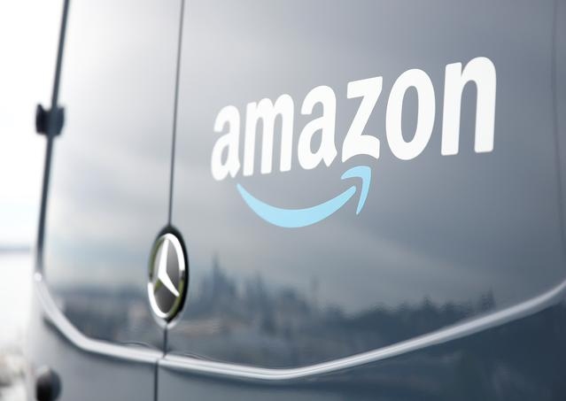FILE PHOTO: An Amazon Prime van during a press conference announcing Amazon.com's new program to help entrepreneurs build businesses delivering Amazon packages, including $1 million to fund startup costs for military veterans, at an event space in Seattle, Washington, U.S., June 27, 2018.  REUTERS/Lindsey Wasson