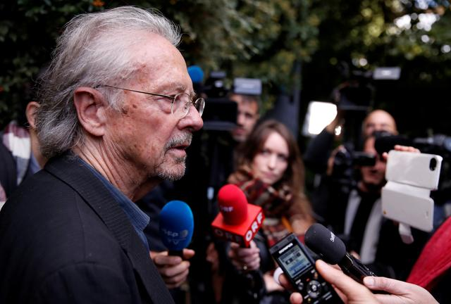 FILE PHOTO: Austrian author Peter Handke addresses the media following the announcement that he had won the 2019 Nobel Prize in Literature, in Chaville, near Paris, France October 10, 2019. REUTERS/Christian Hartmann/File Photo