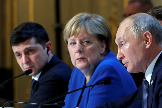 FILE PHOTO: Ukraine's President Volodymyr Zelenskiy, German Chancellor Angela Merkel and Russia's President Vladimir Putin attend a joint news conference after a Normandy-format summit in Paris, France December 10, 2019. REUTERS/Charles Platiau/Pool?/File Photo