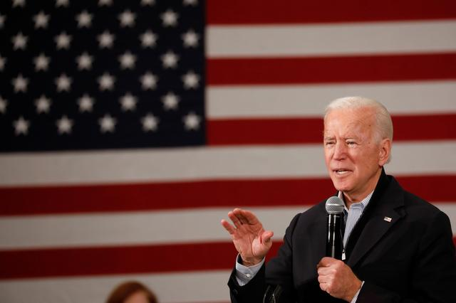 "FILE PHOTO: Democratic 2020 U.S. presidential candidate and former U.S. Vice President Joe Biden speaks during a town hall meeting, during his ""No Malarkey!"" campaign bus tour at Iowa State University in Ames, Iowa, U.S., December 4, 2019.  REUTERS/Shannon Stapleton"