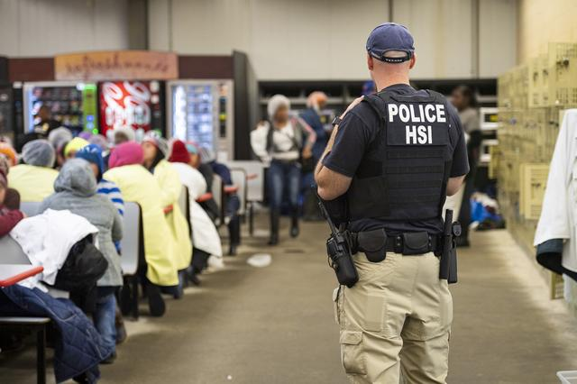 FILE PHOTO: Homeland Security Investigations (HSI) officers from Immigration and Customs Enforcement (ICE) look on after executing search warrants and making some arrests at an agricultural processing facility in Canton, Mississippi, U.S. in this August 7, 2019 handout photo.    Immigration and Customs Enforcement/Handout via REUTERS