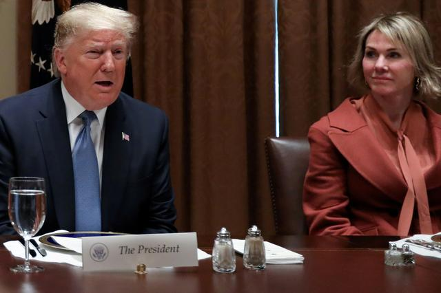 FILE PHOTO: U.S. President Donald Trump — with full-sized salt and pepper shakers — is flanked by U.S. Ambassador to the United Nations Kelly Craft, with the smaller salt and pepper shakers used by Trump's guests, as he hosts a lunch for ambassadors to the U.N. Security Council at the White House in Washington, U.S. December 5, 2019. REUTERS/Jonathan Ernst