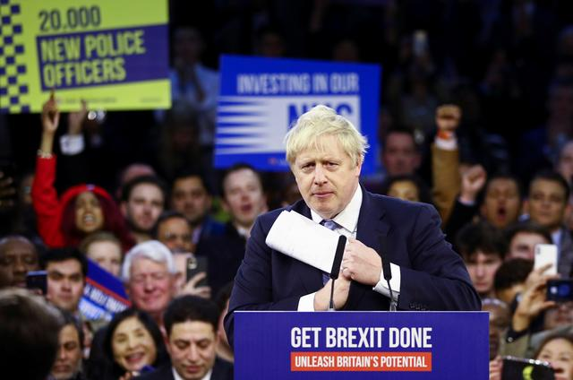 Britain's Prime Minister Boris Johnson gestures during a final general election campaign event in London, Britain, December 11, 2019.  REUTERS/Hannah McKay