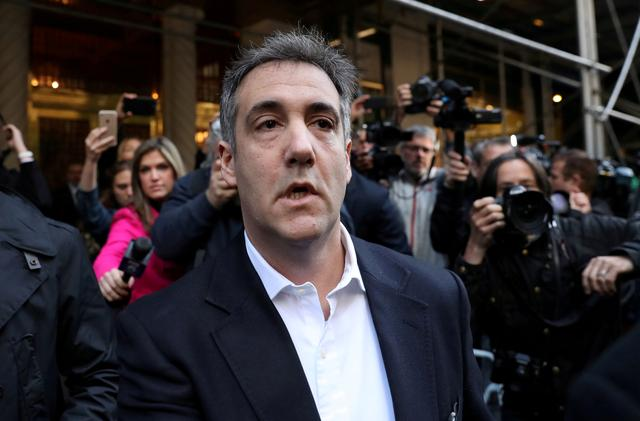 FILE PHOTO: Michael Cohen, U.S. President Donald Trump's former lawyer, leaves his apartment to report to prison in Manhattan, New York, U.S., May 6, 2019. REUTERS/Jeenah Moon