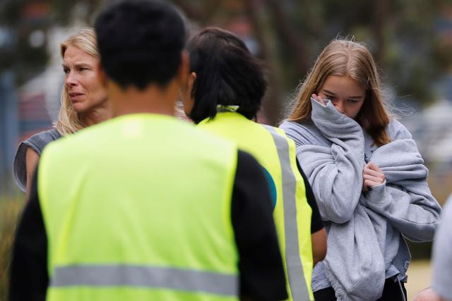 "Relatives of the volcano eruption victims react after attending a ceremony called ""Karakia"" with Ngati Awa representatives, at Mataatua Marae house in Whakatane, New Zealand, December 12, 2019. REUTERS/Jorge Silva"