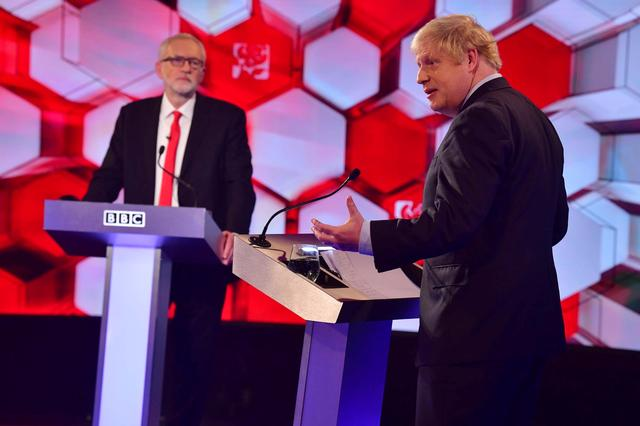 FILE PHOTO: Britain's Prime Minister Boris Johnson and opposition Labour Party leader Jeremy Corbyn face each other in a head-to-head debate on the BBC in London, Britain December 6, 2019. Jeff Overs/BBC/Handout via REUTERS