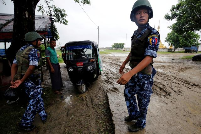 FILE PHOTO: Myanmar police officer stands guard in Maungdaw, Rakhine July 9, 2019. REUTERS/Ann Wang/File Photo