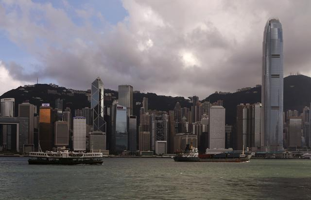FILE PHOTO: A Star Ferry sails past Hong Kong's business Central district June 18, 2014.  REUTERS/Bobby Yip